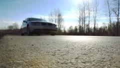 Car quickly passes along a country road Stock Footage