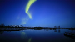 Aurora borealis northern lights calm water lake mirror reflection, Iceland 4k Stock Footage