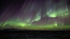Bright active Aurora borealis northern lights lava field Thingvellir Iceland 4k  Stock Footage