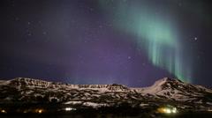 Northern lights aurora borealis snow capped Mt. Esja Reykjavik, Iceland Stock Footage