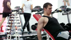 Young muscular man hard training biceps in gym Stock Footage