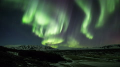 Active northern lights aurora borealis, mountain valley, Thingvellir, Iceland 4k - stock footage