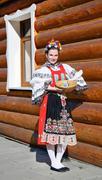 The smiling girl in folk costume - stock photo