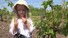 4K Little Countrywoman Girl Eating Grapes Vineyard Portrait Child Playing Field Stock Footage