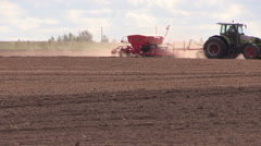 Tractor with special equipment fertilize sow field in autumn Stock Footage