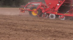 Agriculture machinery spread fertilizer on field soil Stock Footage