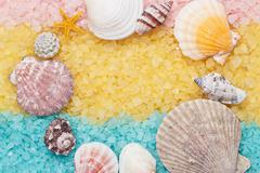 Blue and yellow bath salt and seashells background Stock Photos