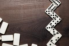 domino pieces on the wooden table background - stock photo