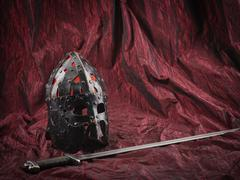 Medieval helmet and sword - stock photo