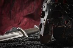 Medieval armour, helmet and sword - stock photo
