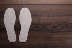 Insoles for shoes on wooden background Stock Photos