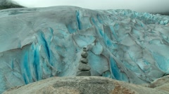 Rock cairn and retreating Scandinavian Jostedalsbreen glacier (climate change) Stock Footage