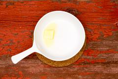 Melting Butter on White Serving Plate with handle - stock photo