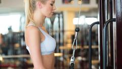Girl doing exercise for the chest in the gym Stock Footage