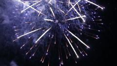 Beautiful volleys fireworks in the night sky - stock footage