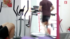 Men hard training in gym running track and biceps pumping Stock Footage