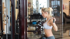 Girl doing exercise for the chest Stock Footage