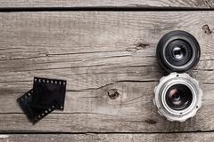 retro camera lenses and negative film - stock photo