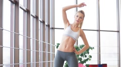 Girl doing exercise for the back Stock Footage