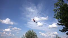 4K Children Climbing in Forest, Sliding Adventure Park, Extreme Sport Flying Fox Stock Footage