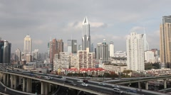 skyline and busy traffic on elevated expressway in modern city ,shanghai. - stock footage