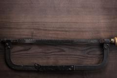 old hacksaw rusty on wooden background - stock photo
