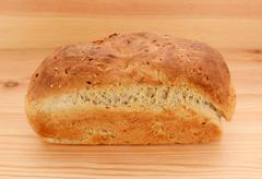 Freshly baked loaf of crusty bread - stock photo