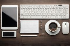 Overhead of essential office objects in order Stock Photos
