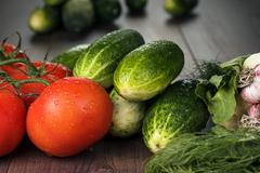 fresh vegetables on brown wooden table - stock photo