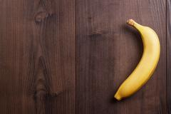 banana on the brown wooden background - stock photo