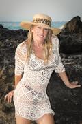 Mature woman in bikini and fishnet dress Stock Photos