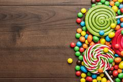 Different colorful sweets and lollipops Stock Photos