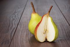 fresh pears on wooden table - stock photo