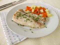 Perch fillet with vegetables and cress Stock Photos