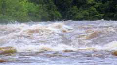 The powerful flow of the river after a tropical rain, Equator, Africa Stock Footage