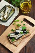 Sprats on crispbread Stock Photos