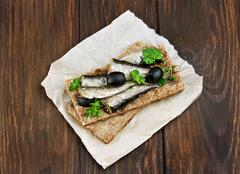 Fish sandwich with sprats and olives Stock Photos