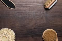 some bath accessories over wooden background - stock photo