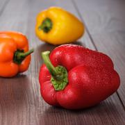 sweet peppers on the table - stock photo
