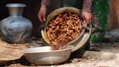 Woman of Marma hill tribe cooks outside of the house in Bandarban, Bangladesh. Stock Footage