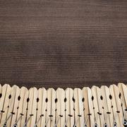 wooden clothes pegs on the table - stock photo