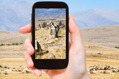 Tourist photographs menhirs Zorats Karer Armenia Stock Photos