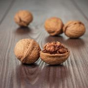 walnuts on the brown wooden table - stock photo