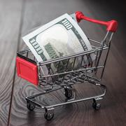 A hundred dollars in the shopping trolley Stock Photos