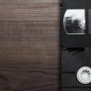 Old retro video tapes over wooden background Stock Photos