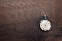 Stopwatch over brown wooden background Stock Photos