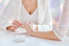 Close up of lesbian couple hands with wedding ring Stock Photos