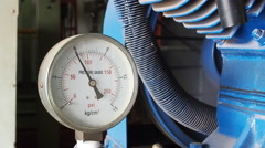Close up pressure gauge with compressor working. - stock footage