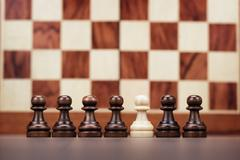 uniqueness concept over chessboard background - stock photo
