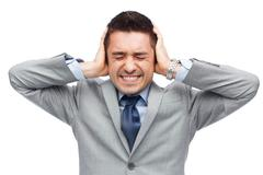 businessman in suit having head ache - stock photo